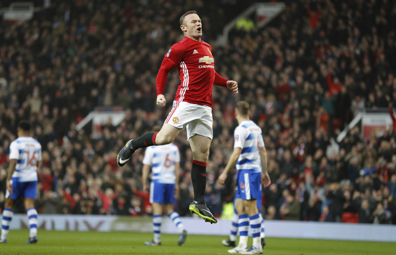 Manchester United's Wayne Rooney celebrates scoring their first goal. Photo: Reuters