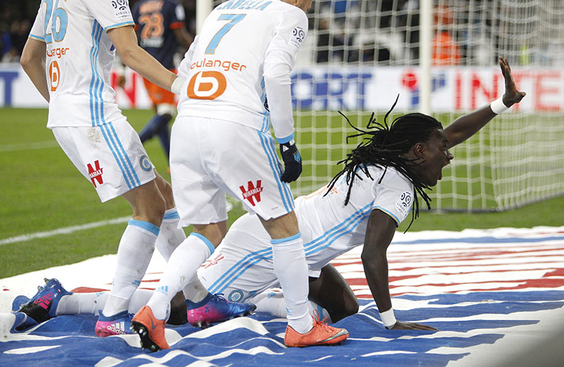 Marseille's forward Bafetimbi Gomis (bottom) reacts after scoring during the League One soccer match between Marseille and Montpellier, at the Velodrome Stadium, in Marseille, southern France, on Friday, January 27, 2017. Photo: AP