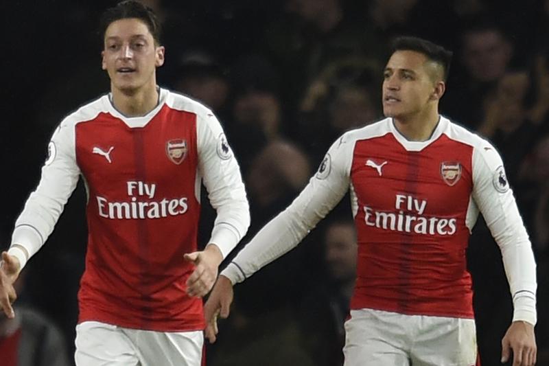Arsenal's Mesut Ozil celebrates scoring their second goal with Alexis Sanchez. Photo: Reuters