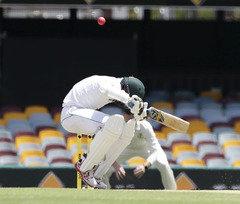Pakistan's Muhammad Amir ducks under a bouncer during play on day three of the first cricket test match between Australia and Pakistan in Brisbane, Australia, on Saturday, December 17, 2016. Photo: AP