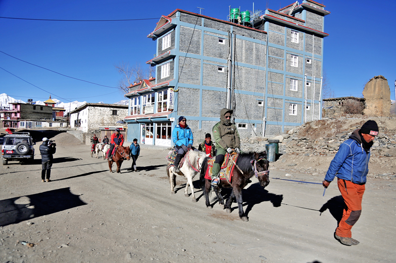 Devotees ride on horses on their way to the Muktinath Temple of Mustang district, on Saturday, January 14, 2017. Photo: RSS