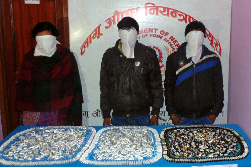 Three arrestees made public by the Narcotics Control Bureau of Nepal Police along with the confiscated controlled drugs found from their possession, in Kathmandu, on Monday, January 2, 2017. Photo: NCB