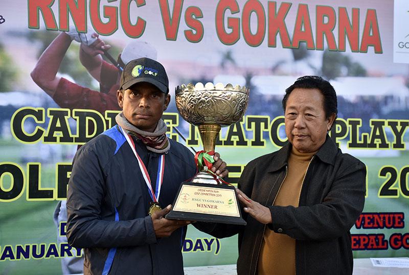 Nepal Golf Association President Madhukar Yakthumba (right) handing over the trophy to RNGCu2019s Krishna Nepal after Caddie Match Play in Kathmandu. Photo: Naresh Krishna Shrestha/THT