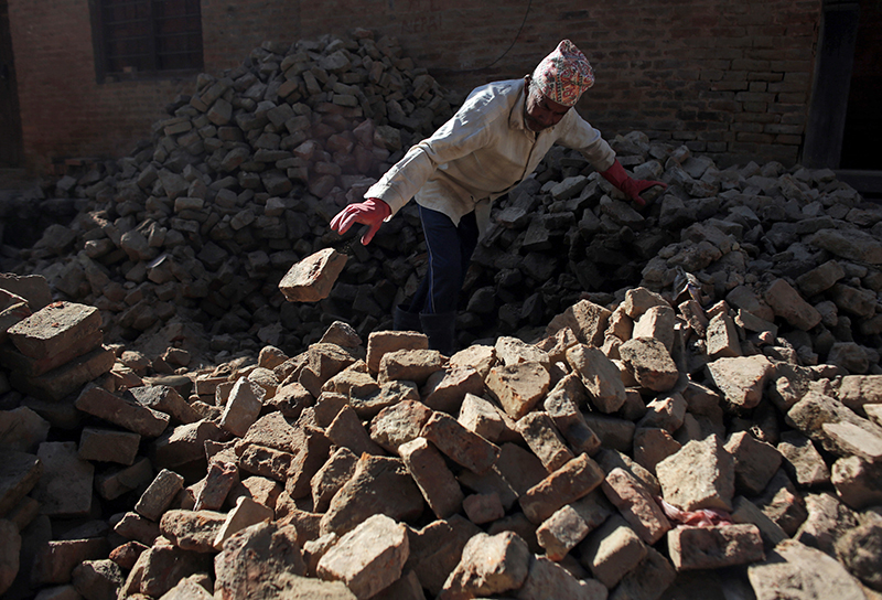 A labourer works on the reconstruction of a damaged Heritage site, in Bhaktapur, on Wednesday, January 4, 2017.