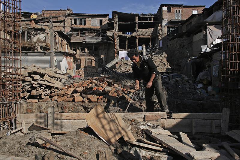 Shree Krishna Chusyabagaa works on his house construction, in Bhaktapur, on Wednesday, January 4, 2017.