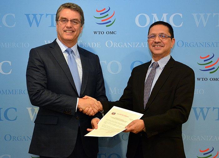 Nepalu2019s Ambassador Deepak Dhital (right) presents TFA's instrument of acceptance to WTO DG Azevu00eado in Geneva on Tuesday, January 24, 2017. Photo: WTO