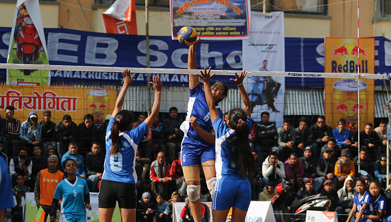 Players of New Diamond Academy and Chandeshwori Youth Club (front) in action during their 12th Blue Sky TVS Dhorpatan Womenu2019s Double League Volleyball Tournament match in Kathmandu on Wednesday, January 11, 2016. Photo: THT
