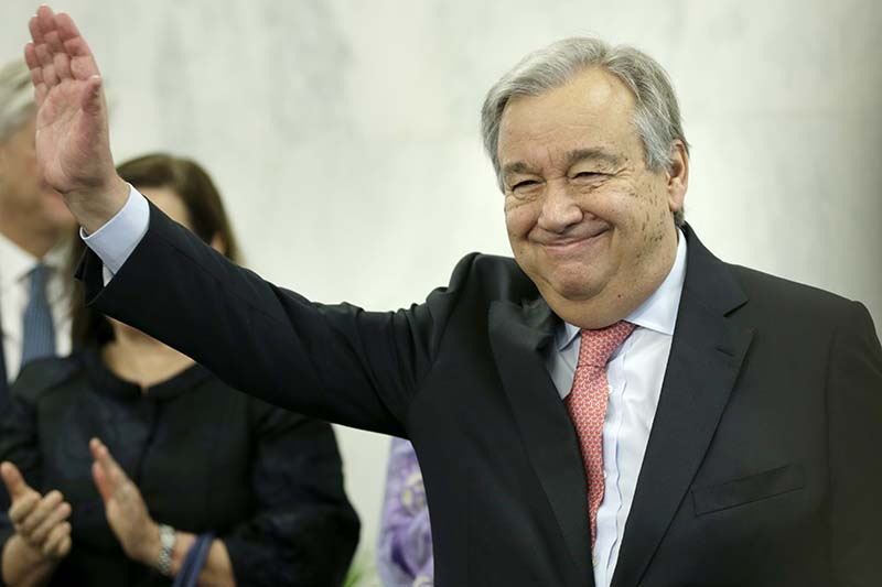 United Nations Secretary-General Antonio Guterres waves after talking with members of the UN staff at UN headquarters, on Tuesday, January 3, 2017. Photo: AP