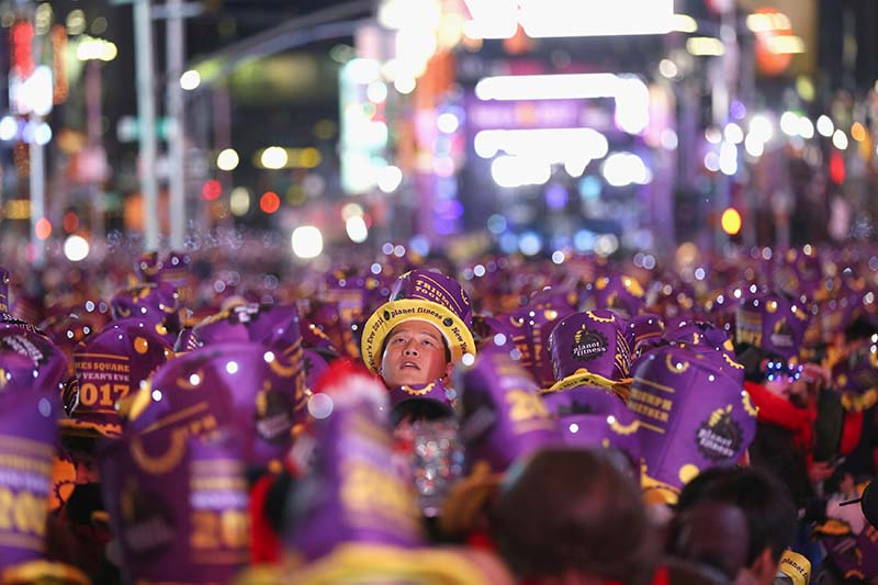 A reveler in Times Square in preparation for the New Year's celebration in Manhattan, New York City, on December 31, 2016. Photo: Reuters