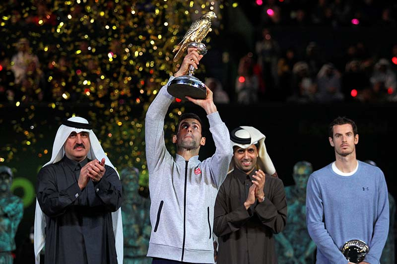 Novak Djokovic of Serbia holds the trophy after his win against Andy Murray of Britain during the men's singles final of the Qatar Open at Doha, Qatar, on January 7, 2017. Photo: Reuters