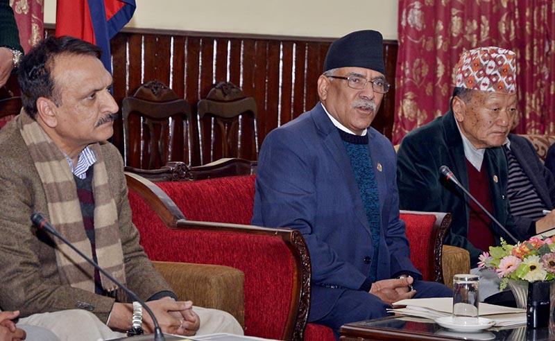 PM Dahal (centre) speaks at a press conference in Baluwatar. Photo: PM's Secretariat