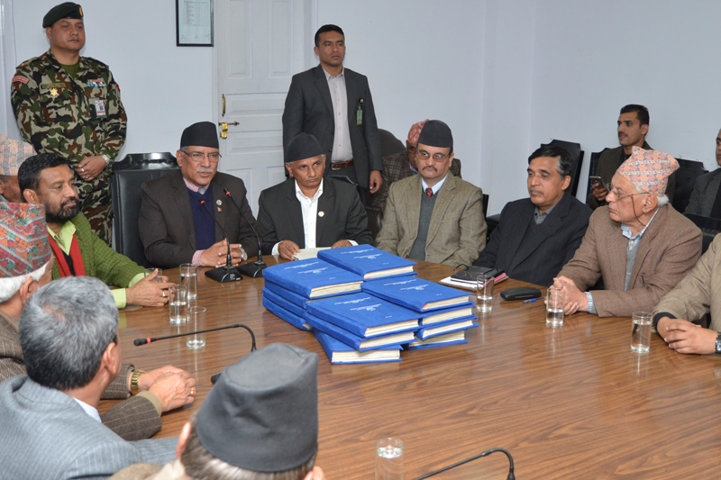 FILE: Prime Minister Pushpa Kamal Dahal with his Cabinet colleagues receives the report of Local Bodies Restructuring Commission, in Kathmandu, on Friday, January 6, 2017. Photo: PM's Secretariat