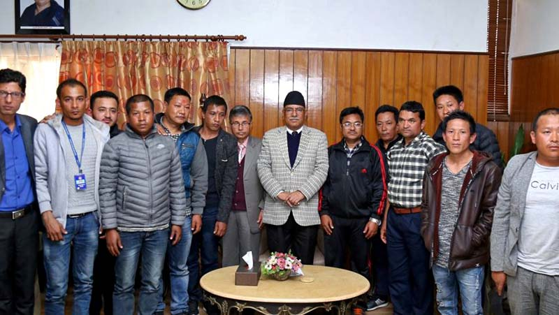Prime Minister Pushpa Kamal Dahal with Nepalis freed from a jail in Saudi Arabia, at his residence in Baluwatar, on Tuesday, January 31, 2017. Photo Courtesy: PM's Secretariat