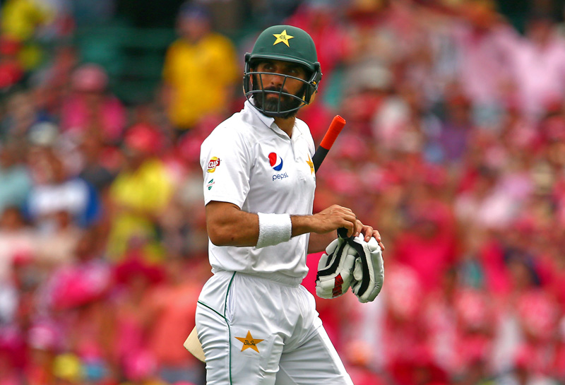 Pakistan's Misbah-ul-Haq reacts as he walks off the ground after being caught out by Australia's Jackson Bird. Photo: Reuters