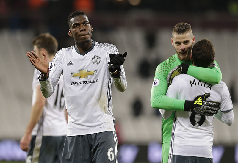 Manchester United's Paul Pogba applauds his teams fans after the end of the English Premier League soccer match between West Ham United and Manchester United at the London stadium, in London on Monday, January 2, 2017.United won the game 2-0. Photo: AP