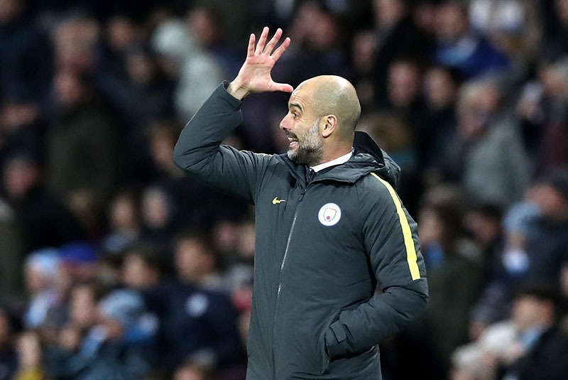 Manchester City's manager Pep Guardiola gestures on the touchline, during the English Premier League soccer match between Manchester City and Burnley, at the Etihad Stadium, in Manchester, England, on Monday, January 2, 2017. Photo: Martin Rickett/PA via AP