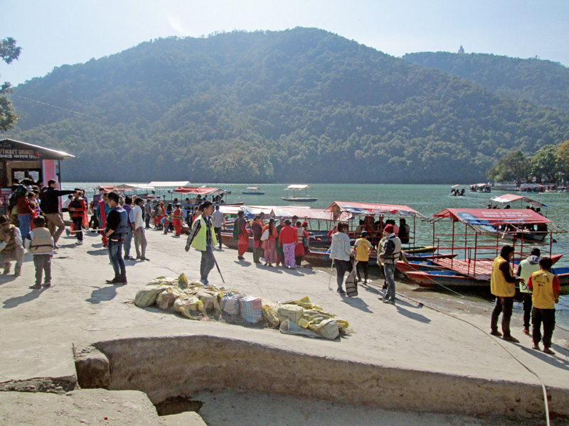 Visitors are seen standing on the shore to board a boat to Tal Barahi Temple at the centre of the Phewa Lake, in Pokhara, on Sunday, January 29, 2017. Photo: Rishi Ram Baral