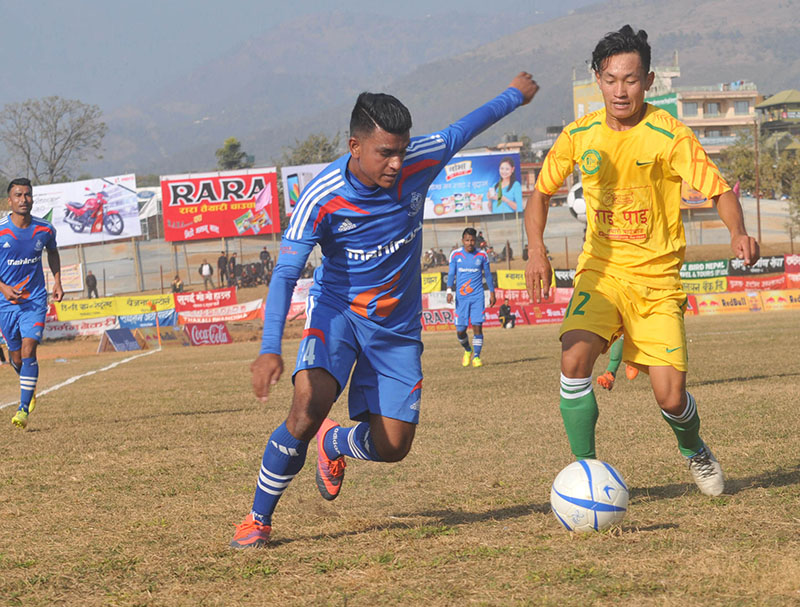 Players of Nepal APF Club and Dharan Football Club (right) vie for the ball during their 15th Aaha-Rara Gold Cup Football Tournament match at the Pokhara Stadium on Wednesday, January 18, 2017. Photo: THT