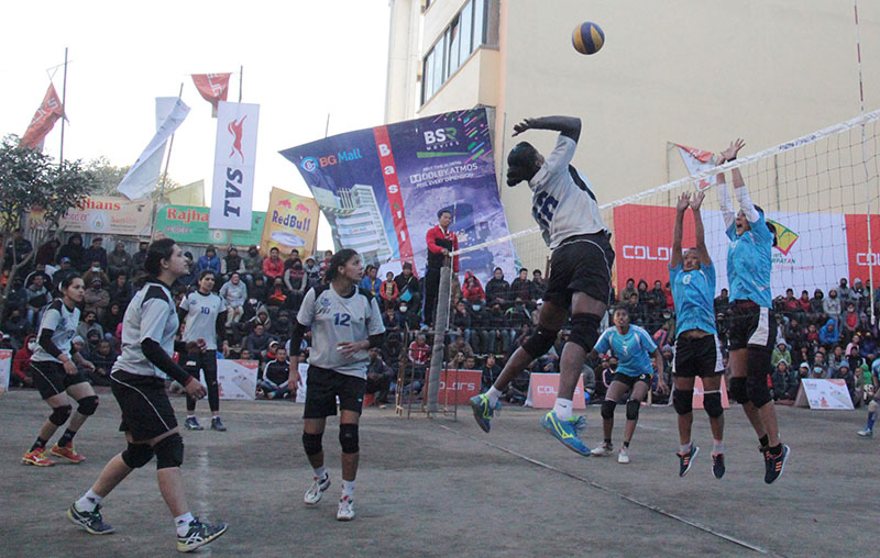 Players of Reed Model School and NPC (right) in action during their 12th Dhorpatan Blue Sky TVS Womenu2019s Double League Volleyball Tournament match in Kathmandu, on Wednesday, January, 2017. Photo: THT