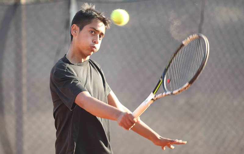 Pranav Khanal returns to Dawa Sherpa during their menu2019s singles match of the ninth Sahabir Memorial Open Lawn Tennis Tournament in Lalitpur on Thursday, January 26, 2017. Photo: THT