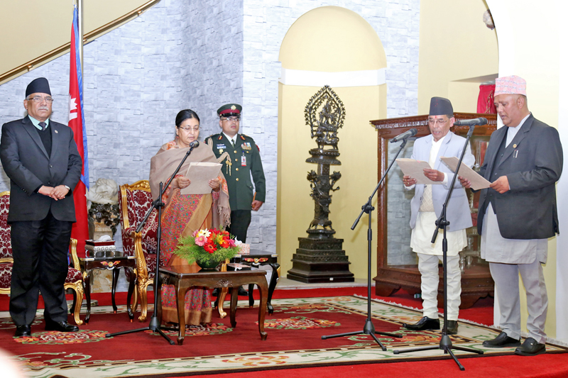 President Bidya Devi Bhandari administers the oath of office and secrecy to two newly appointed ministers, Prem Bahadur Singh (2nd from right) as Minister for Water Supply and Sanitation  and Kumar Khadka as Minister for Women, Children and Social Welfare, in presence of Prime Minister Pushpa Kamal Dahal at the Sheetal Niwas in Kathmandu, on Thursday, January 19, 2017. Photo: RSS