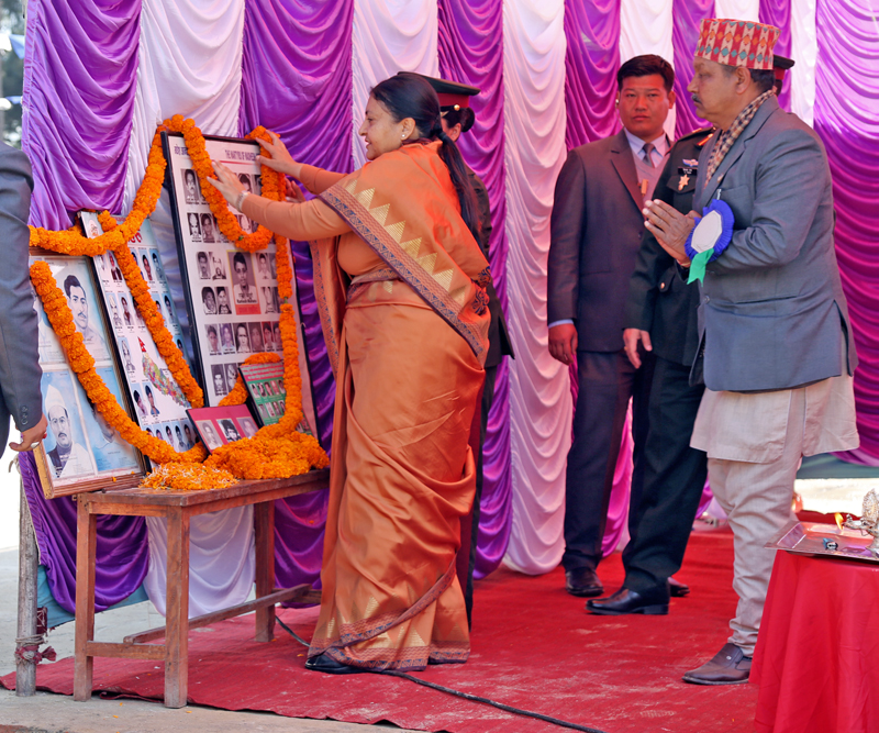 President Bidya Devi Bhandari offers garlands to the martyrs at a programme organised on the occasion of the Martyrs' Day in Gokarna on the northern outskirts of Kathmandu, on Sunday, January 29, 2017. Photo: RSS