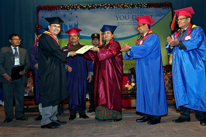 President Bidya Devi Bhandari hands out a certificate to a CA graduate amid the first convocation of the Nepal Chartered Accountants in Kathmandu, on Tuesday, January 31, 2017. Photo: RSS
