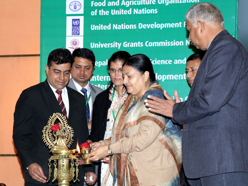 President Bidya Devi Bhandari lights a panas to inaugurate the International Conference on Biodiversity, Climate Change Assessment and impacts on Livelihood, in the Capital, on Tuesday, January 10, 2017. Photo: RSS