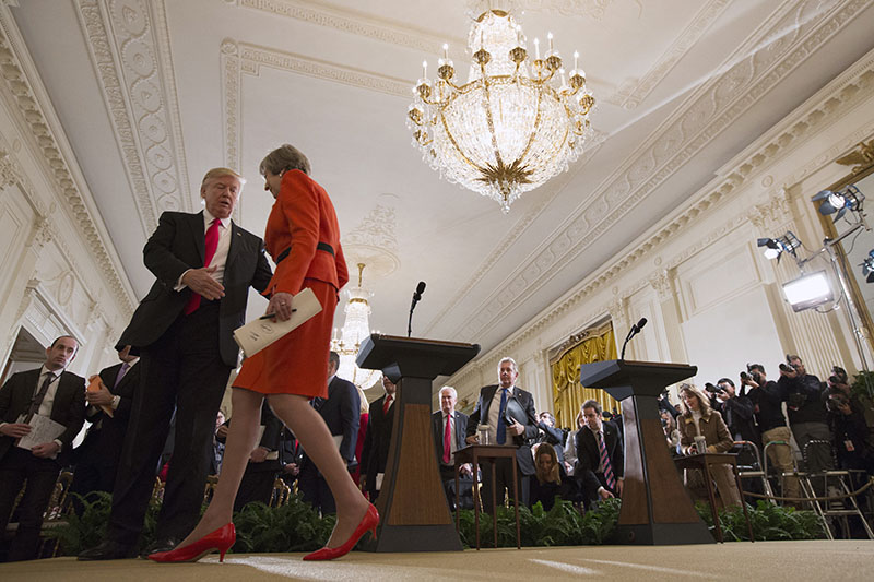 President Donald Trump reaches out to shake hands with British Prime Minister Theresa May after a news conference in the East Room of the White House in Washington, Friday, Jan. 27, 2017. (AP Photo/Evan Vucci)