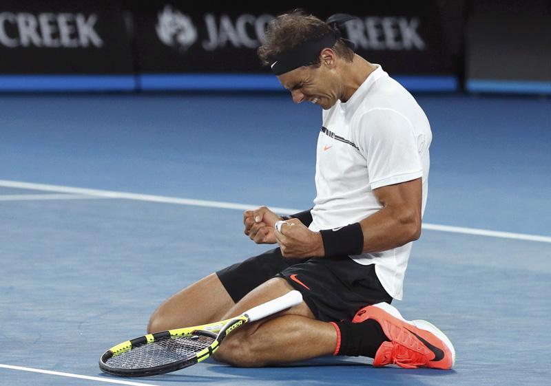 Spain's Rafael Nadal celebrates winning his Men's singles quarter-final match against Canada's Milos Raonic. Photo: Reuters