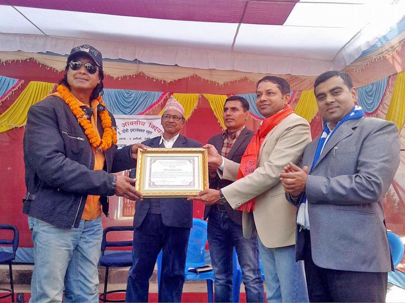 Nepali cinema superstar Rajesh Hamal being felicitated by a local school in Byas Municipality-1 of Tanahun district, on Monday, January 23, 2017. Photo: Madan Wagle