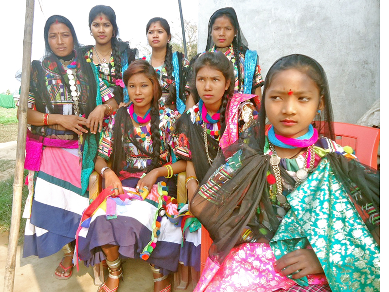 Women of Rana Tharu Community clad in their traditional attires wait to welcome guests for homestay in Bhimdutta Municipality of Kanchanpur district, on Wednesday, January 18, 2017. Photo: RSS