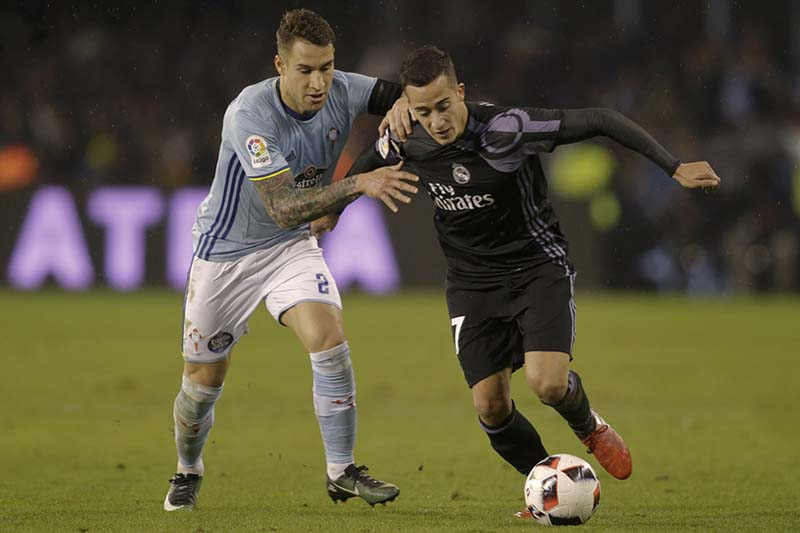 Real Madrid's Lucas Vazquez (right) and Celta Vigo's Hugo Mallo in action during a match of the Spanish King's Cup at the Balaidos stadium in Vigo, Spain, on Wednesday, January 25, 2017. Photo: Reuters