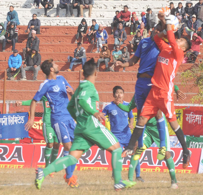 Players of Sahara Club (green) and Far-west Sporting Club in action during their 15th Aaha-Rara Gold Cup match in Pokhara, on Tuesday, January 17, 2017. Photo: THT