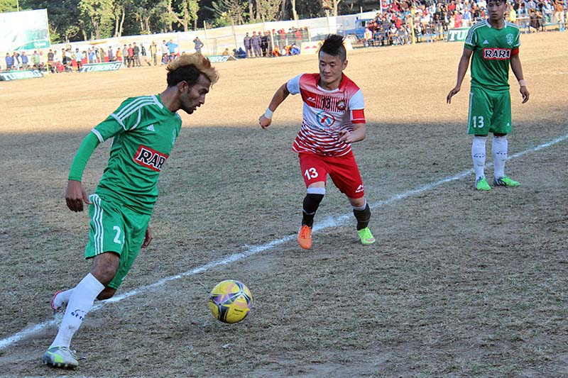 Players of Sahara Club and Delhi United (centre) vie for the ball during their second Tuborg Hetauda Gold Cup International Invitational Tournament match on Tuesday, January 3, 2016. Photo: THT