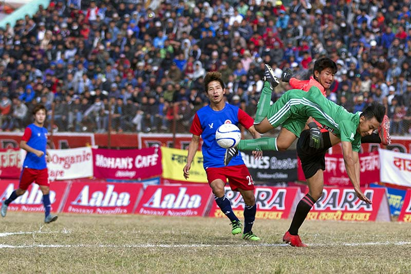 Players of Sahara Club and Sikkim United FC (left) vie for the ball during their 15th Aaha Rara Gold Cup match at the Pokhara Stadium on Saturday, January 21, 2017. Photo Courtesy: Yunish Gurung