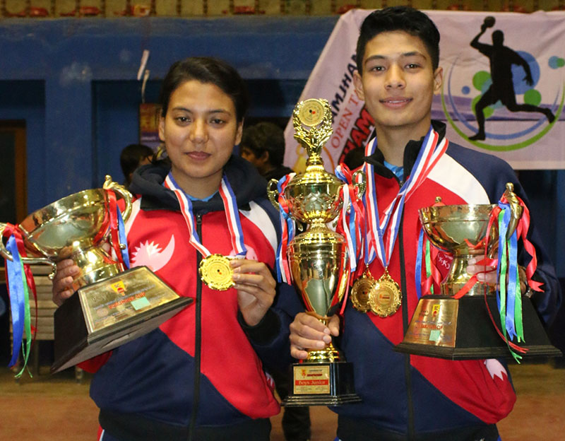 NPCu2019s Elina Maharjan and Shyantu Shrestha hold medals after winning the Samjhana Cup Open Tennis Tournament, on Sunday, January 29, 2017. Photo: THT