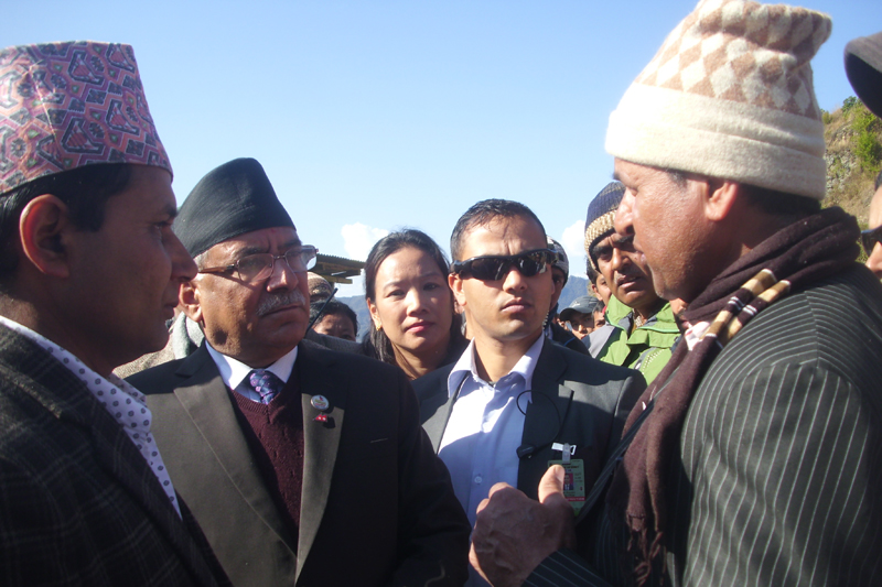 A fire victim in Sankranti Bazaar of Terhathum district talks with Prime Minister Pushpa Kamal Dahal as the latter visits the site of December 16 inferno, on Tuesday, January 3, 2017. Photo: Laxmi Gautam