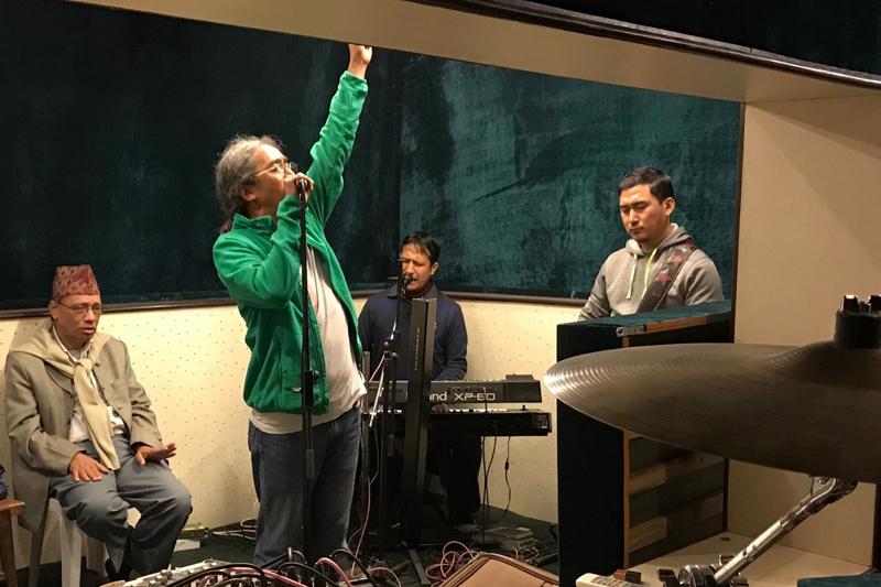 Lyricist Sarubhakta (left) listens to Nepathya frontman Amrit Gurung sing his song during a rehearsal, in Kathmandu, in January 2017. Photo: Nepalaya