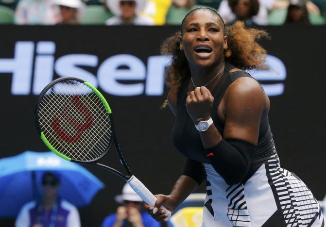 Serena Williams of the U.S. reacts during her Women's singles first round match against Switzerland's Belinda Bencic. REUTERS/Jason Reed