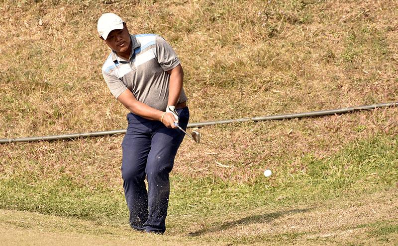 Nepal No 1 pro Shivaram Shrestha plays a shot on the ninth green during the third round of the Surya Nepal Challenge at the Royal Nepal Golf Cub in Kathmandu on Thursday, January 12, 2017. Photo: Naresh Shrestha/THT