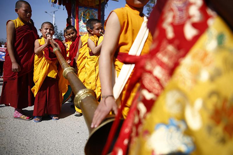 Buddhist monks play instruments while taking part in a parade to celebrate Sonam Lhosar festival, in Kathmandu, on Saturday, January 28, 2017. Photo: Skanda Gautam/THT