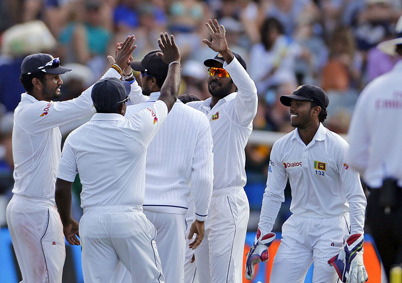 Sri Lanka team members react after taking the wicket of South Africa Temba Bavuma, during the 2nd Test cricket match between South Africa and Sri Lanka in Cape Town, South Africa, on Monday, January 2, 2017. Photo: AP