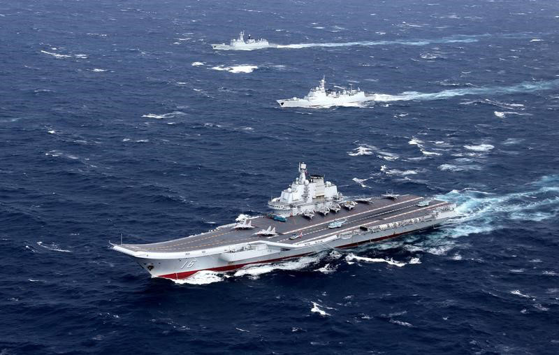 File - China's Liaoning aircraft carrier with accompanying fleet conducts a drill in an area of South China Sea, in this undated photo taken in December, 2016. Photo: Reuters