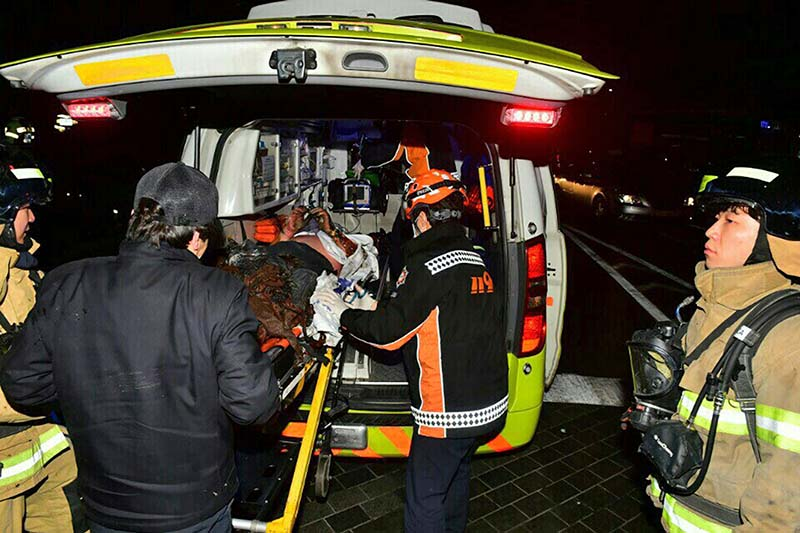 An injured Buddhist monk who set himself on fire is put into an ambulance in Seoul, South Korea on Saturday, January 7, 2017. Photo: Yonhap via AP