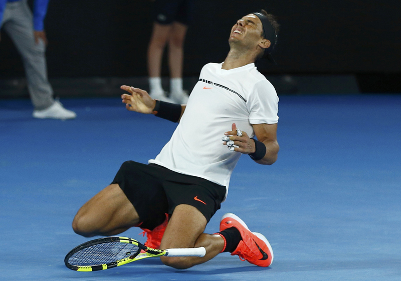 Spain's Rafael Nadal falls onto the court as he celebrates winning his Men's singles semi-final match against Bulgaria's Grigor Dimitrov. Photo: Reuters