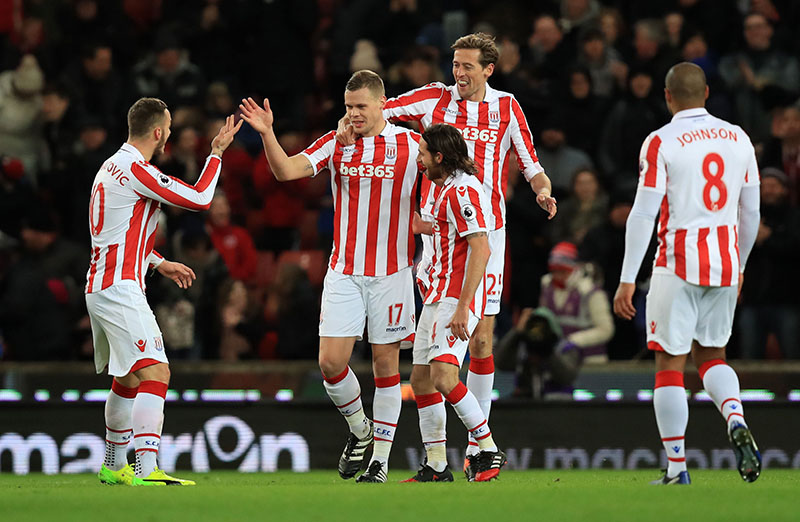 Stoke City's Ryan Shawcross (second left) celebrates scoring his sides opening goal against Watford during their English Premier League soccer match at the Bet365 Stadium in Stoke, England, on Tuesday, January 3, 2017. Photo: Mike Egerton / PA via AP