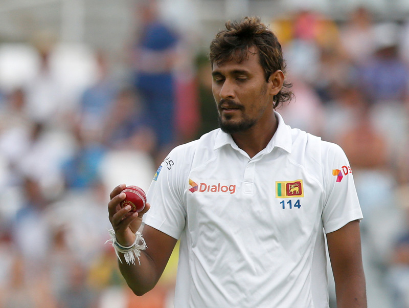 Sri Lanka's Suranga Lakmal examines the ball. Photo: Reuters