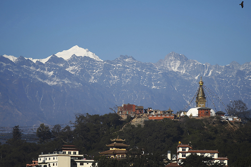 The Swayambhunath Stupa, a UNESCO World Heritage Site, is pictured against the backdrop of a mountain range seen on a clear-sky day in Kathmandu, on Friday, January 20, 2017. Photo: Skanda Gautam