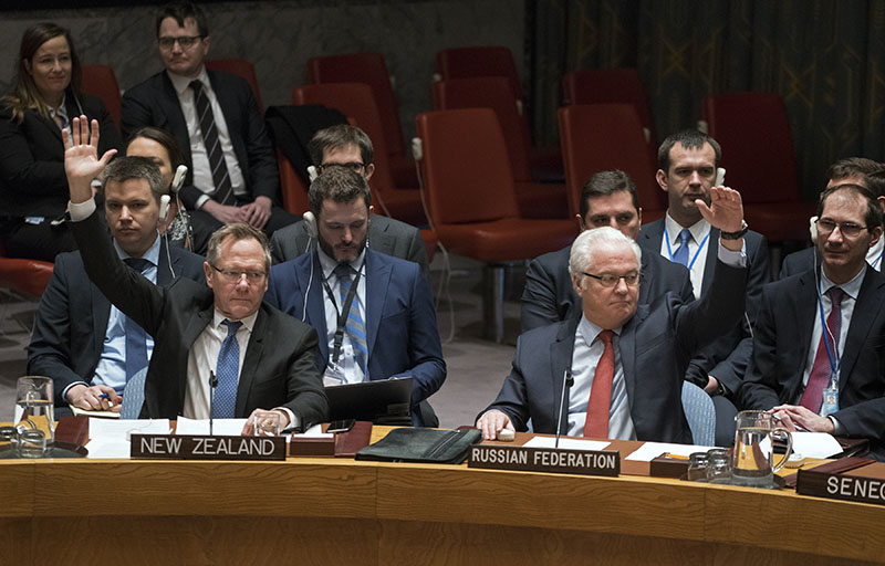 New Zealand's UN Ambassador Gerard van Bohemen (left) and Russia's ambassador to the UN, Vitaly Churkin, raise their hands as they join other members of the Security Council at the United Nations headquarters on Saturday, December 31, 2016, passing a resolution supporting efforts by Russia and Turkey to end violence in Syria and jumpstart peace negotiations. Photo: AP